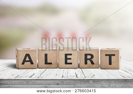 Alert Warning Sign On A Wooden Table At A Restriction Area With A Blurry Background