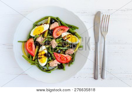 Summer Warm Salad With Cooked Green Beans, Tuna, Tomatoes, Boiled Eggs And Sauce Balsamico Glassa In