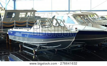 Fishing Boat. Motor Boat For Sale In The Store. Located On A Wheeled Cart.