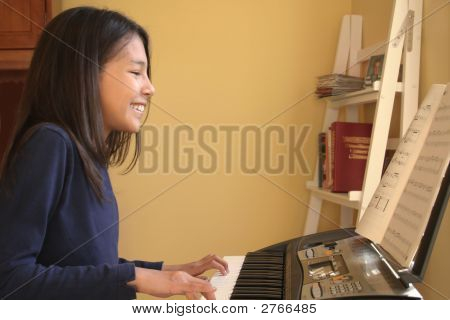 Cute Teen Playing Piano