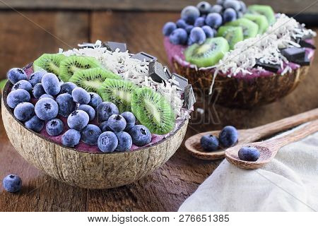 Açai Smoothie Bowl With Fresh Kiwi, Frozen Blueberries, Organic Coconut And Dark Chocolate Pieces Wi