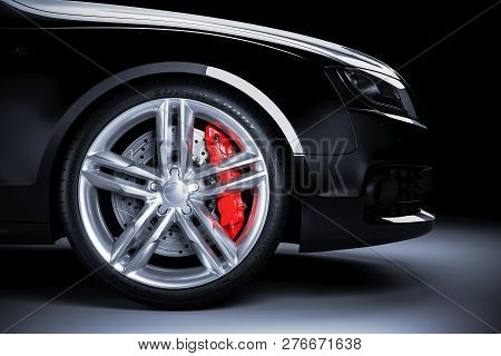 Sports Car Wheel With Red Brakes In Studio Lighting. 3d Render