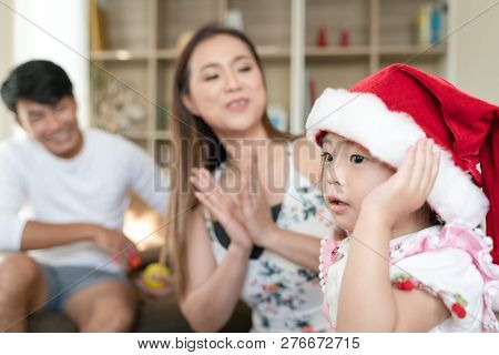 Little Daughter With Santa Hat
