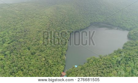 Aerial View Of Lake Bulusan In The Mountains With Green Rain Forest. Lake Hidden In The Jungle Mount
