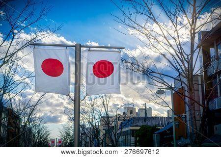 Japanese Flags Waving In The Wind In The City Of Kamakura, Japan.