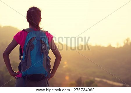 Young Woman Hiker Enjoy The View At Sunrise Mountain Peak
