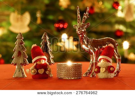 Christmas Table Decoration In Front Of Christmas Tree