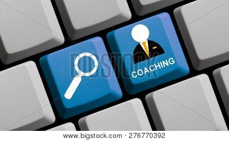 Blue Computer Keyboard With Magnifier Glass Showing Coaching