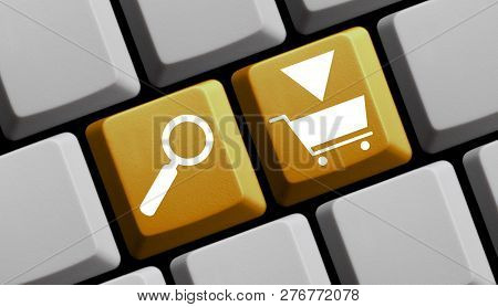 Yellow Computer Keyboard With Magnifier Glass Showing Shopping Or E-commerce