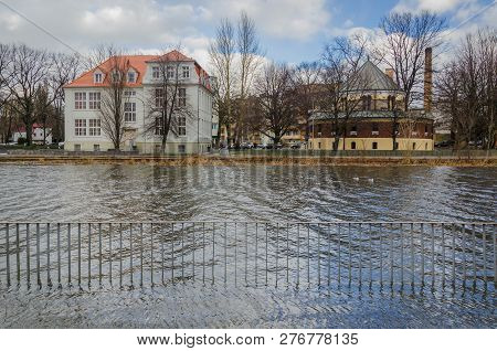 RIVER AND CITY -  Sunken boulevards in the coastal city of Kolobrzeg on the river during a strong storm at sea poster