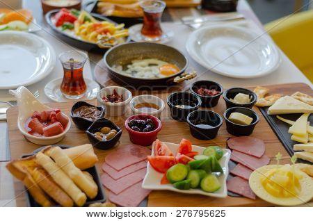 Turkish Breakfast, Tomatoes, Cucumber, Sausage,olive,honey,butter Fried Egg,turkish Tea.