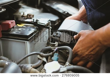 Mechanic Change Air Filter For Car In Automobile Repair Service. Automotive Spare Part Checkup In Ga