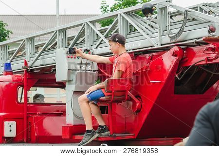 Horki, Belarus - July 25, 2018: A Boy Takes A Selfie On A Red Car Rescue Service 112 On A Holiday In