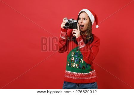 Shocked Young Santa Girl Taking Pictures On Retro Vintage Photo Camera, Keeping Mouth Wide Open Isol
