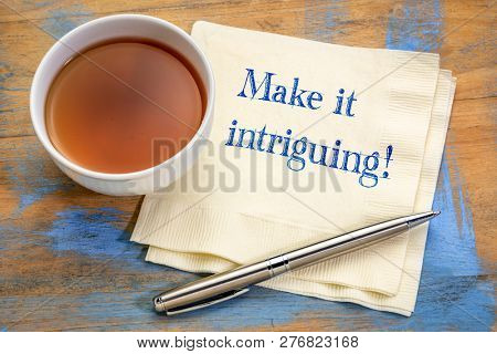make it intriguing advice - handwriting on a napkin with a cup of tea