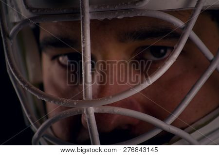 Detail Of A Male Face In A Goalie Hockey Mask.this Is A Detail Hockey Goalie. He Is Concentrated On