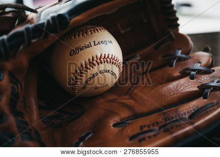 London, Uk - January 3, 2019: Close Up Of A White Baseball Ball Inside Tan Baseball Glove. Originati