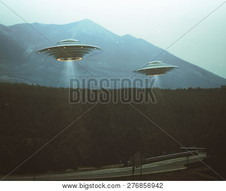 Unidentified Flying Object. Two Ufos Flying Over A Road Among The Trees. 3d Illustration Retro Photo