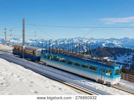 Mt. Rigi, Switzerland - January 25, 2016: A Passenger Train Of The Rigi Railways Leaving The Rigi Ku