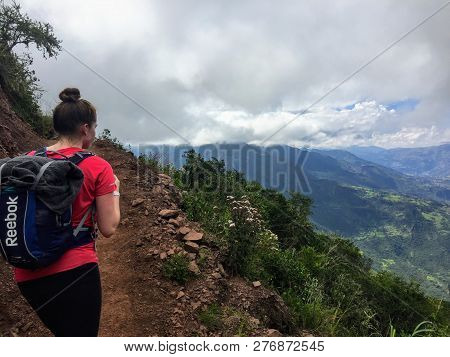 Salkantay, Trail,  Peru - May 7th, 2016: A Young Female Hiker Starts On Her Hike Through The Valleys