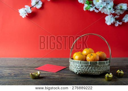 Accessories On Lunar New Year & Chinese New Year Vacation Concept Background.orange In Wood Basket W