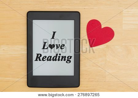 I Love Reading On An E-reader On A Desk With A Red Heart