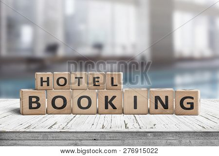 Hotel Booking Sign On A Wooden Step With Blurry Background Of A Residental Suite