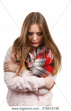 Fashion, Clothes And Clothing Concept. Grumpy Woman Feeling Cold Wearing Warm Scarf Warming Herself