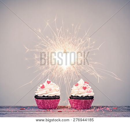 Two Valentines Day Buttercream Cupcakes With Sparklers Creating A Heart Shape Celebrating Love Conce