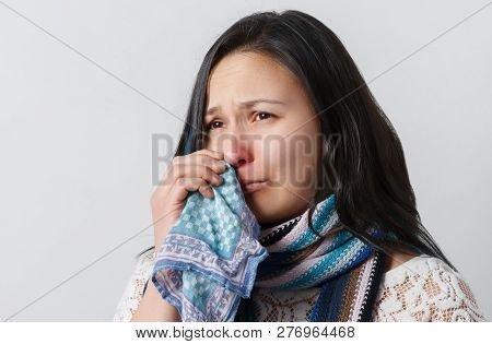 Close Up Portrait Of Beautiful Woman Sneezes And Coughs, Uses Tissue, Rubs Nose, Has Bad Cold, Isola