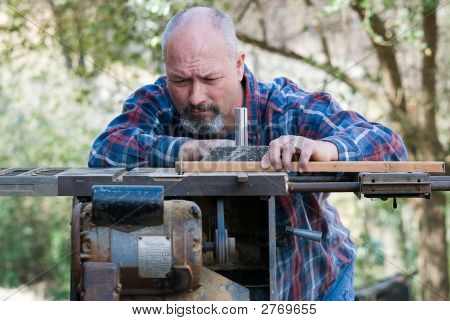 Carpenter Working On Table Saw