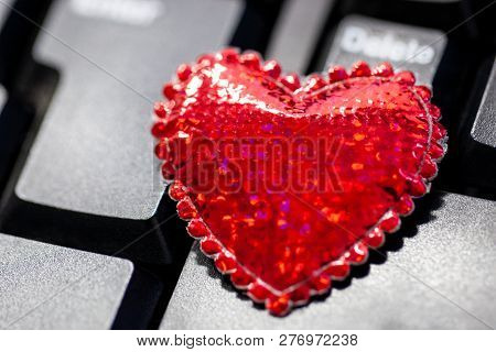The Concept Of Love And Romantic Relationships. Love Affair At Work. Treason. Big Red Heart On The K