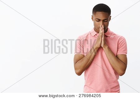Faithful Good-looking Young African American Guy With Closed Eyes And Relaxed Focused Expression Hol