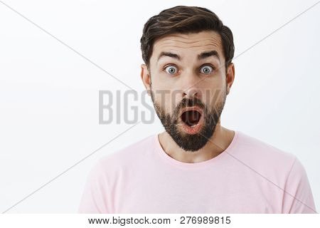 Close-up Shot Of Impressed And Shocked Stunned Caucasian Guy With Beard Dropping Jaw From Amazement