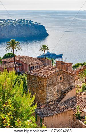 Small Mediterranean Village And Luxury Yacht At The Coast Of Majorca Island, Spain Mediterranean Sea