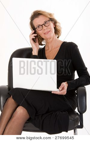 Secretary with laptop and mobile phone