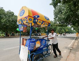 New Delhi, Aug 15, 2018: An Ice Cream Vendor Pushes His Cream Bell Cart On The Streets Of New Delhi.