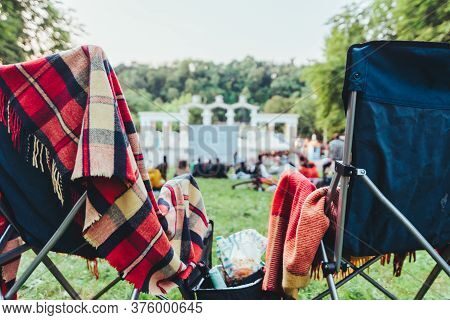 Two Folding Chairs With Cooling Bag With Beer And Snacks In Open Air Cinema