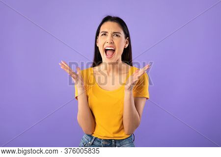 Screaming, Hate, Rage. Crying Emotional Angry Woman Screaming On Pastel Purple Studio Wall