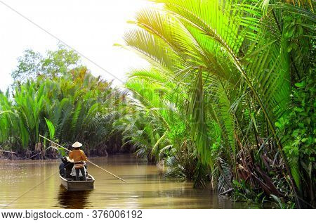 People boating in the delta of Mekong river, Vietnam, Asia