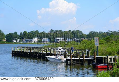 Virginia Beach, U.s.a - June 30, 2020 - The View Of The Boat Dock At Owl's Creek On A Hot Summer Day