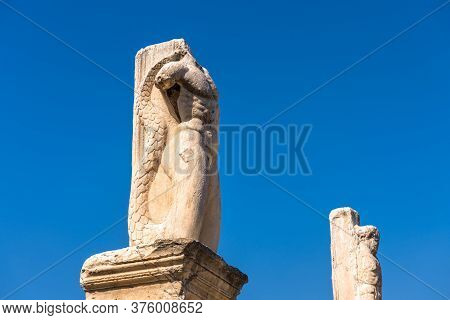 Statues Of Mythological Heroes In Ancient Agora, Athens, Greece. View Of Big Majestic Statues On Blu