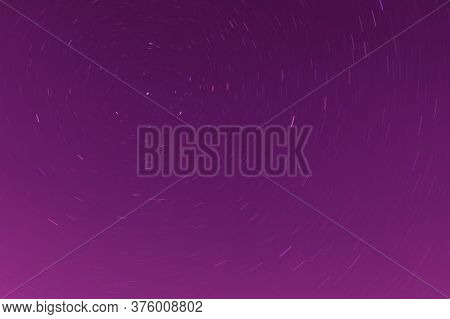 Background Of Round Or Circular Star Track Or Trajectory On The Red, Pink Or Rose Clear Night Sky. S