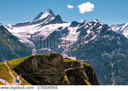 Grindelwald First, Bernese Oberland, Switzerland - July 30 2019 : Tourists Walk On The First Cliff W