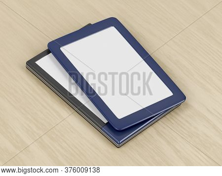 Two Tablets Or E-book Readers With Different Designs And Blank Displays On Wooden Desk. 3d Illustrat