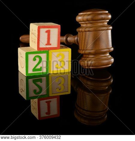 A Gavel And Numbered Blocks Represent The Fundamental Basics Of The Legal System.