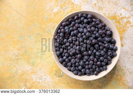 Forest Berries Blueberry, Bramble In A Ceramic Bowl.top View.space For Text.fresh Picked Blueberries