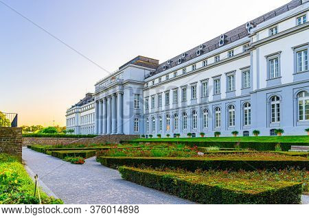 Koblenz, Germany, August 23, 2019: Electoral Palace Schloss Building And Green Bushes In Garden In K