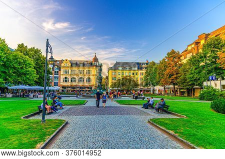 Koblenz, Germany, August 23, 2019: Gorresplatz Square With Old Buildings, History Column Fountain, G
