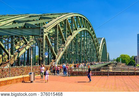 Cologne, Germany, August 23, 2019: People Tourists Walking Down Hohenzollern Bridge Or Hohenzollernb